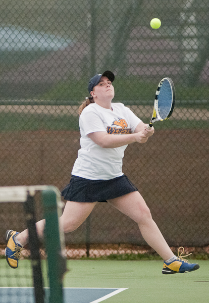 Webster University sophomore Kathleen Kennedy chases a ball that eventually landed out during her doubles match against Missouri Baptist University on Tuesday, April 9 at the Webster Groves Tennis Center. Kennedy possess a 21-0 overall record in her matches in 2013. PHOTO BY BRITTANY RUESS.
